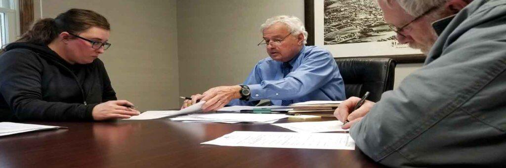 Houlton Maine attorney Philip K Jordan at real estate closing.